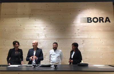 Erstmals auf der Eurocucina: BORA, das erfolgreiche Abluftsystem von Erfinder und Unternehmer Willi Bruckbauer, hier mit dem Mailänder Sternekoch Giancarlo Morelli.